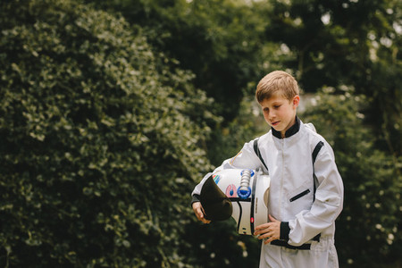 Boy in space suit and helmet