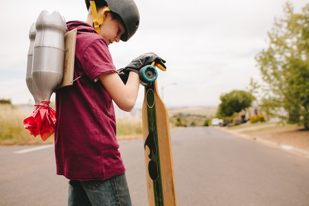 Boy with jetpack and skateboard