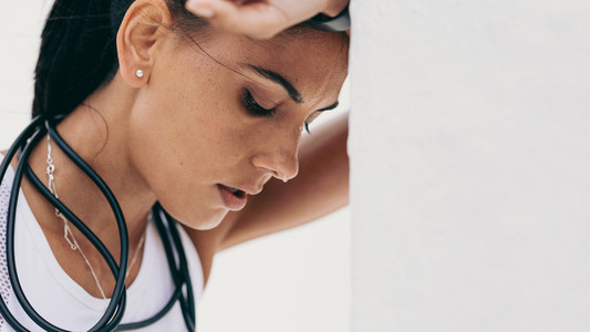 Close up of a tired fitness woman