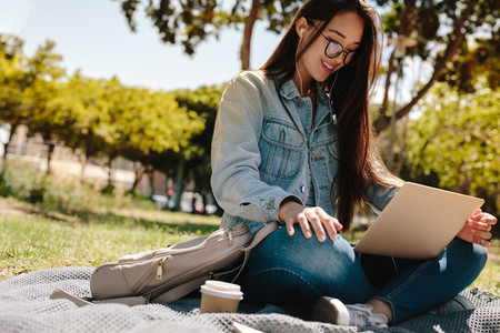 Girl in college campus using a laptop