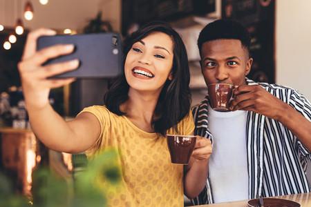 Funny selfie at cafe