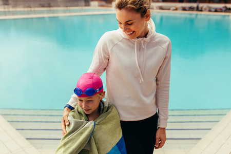 Girl with coach at swimming pool