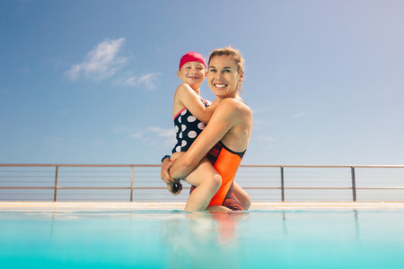 Mother and daughter in a swimming pool