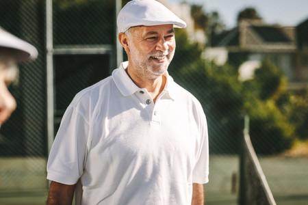 Portrait of  smiling senior man in tennis wear