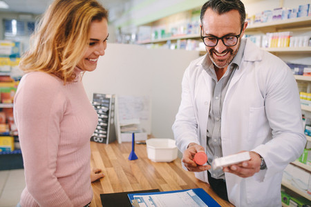 Pharmacist suggesting medical drug to buyer