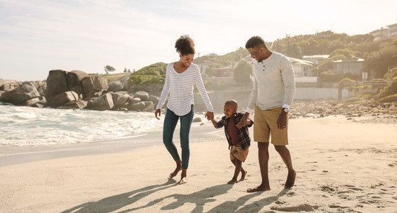 African family on beach walk