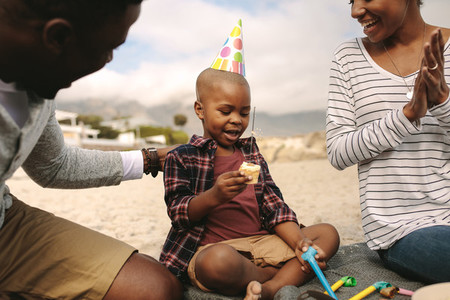 Couple celebrating birthday of their son at the beach