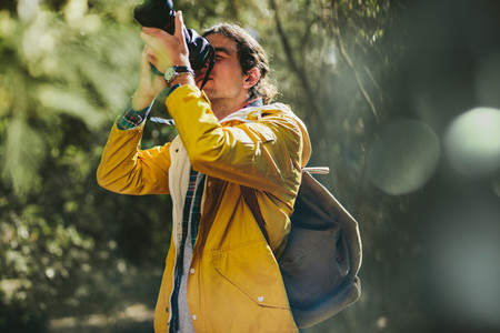 Traveler capturing the beauty of nature in a camera
