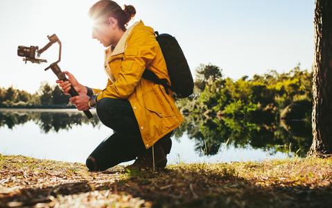 Photographer shooting video using a camera gimbal