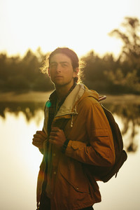 Portrait of a traveler standing outdoors