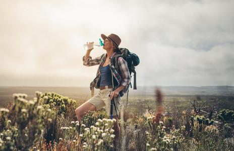 Woman taking a break during her trek