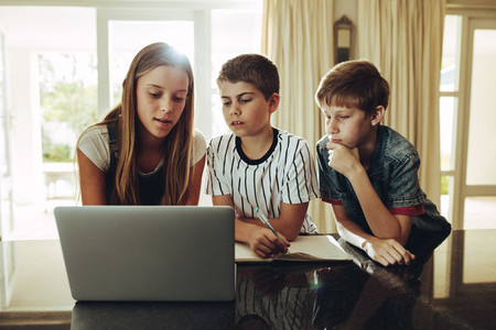 Kids using laptop computer for learning