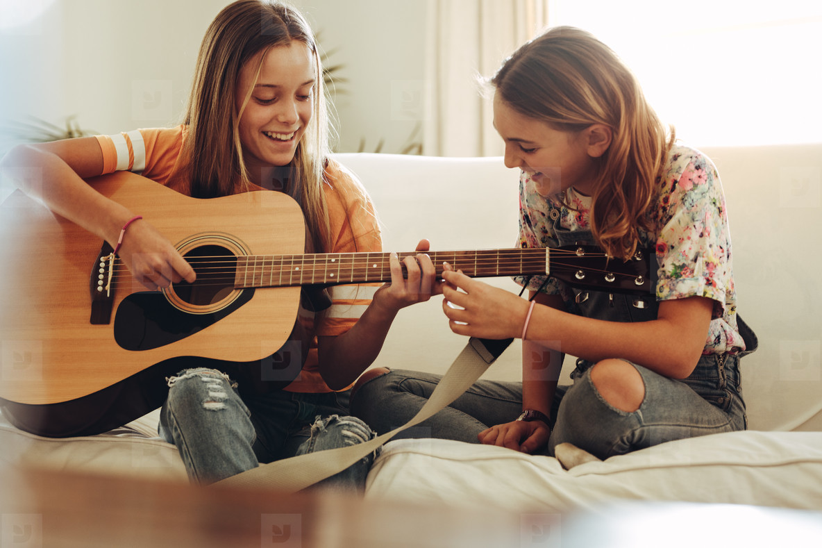 Photos - Girls learning to play guitar 167658 - YouWorkForThem