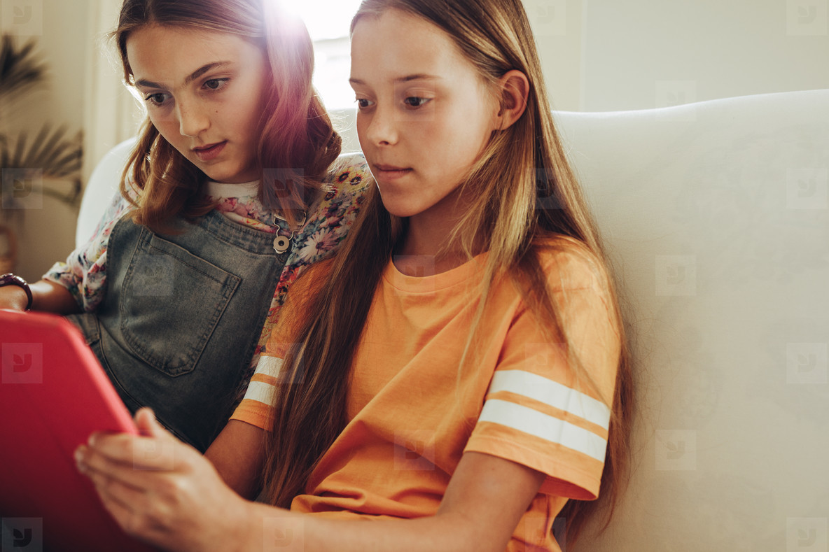Girls looking at a tablet pc