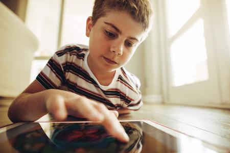 Tech savvy kid using tablet pc