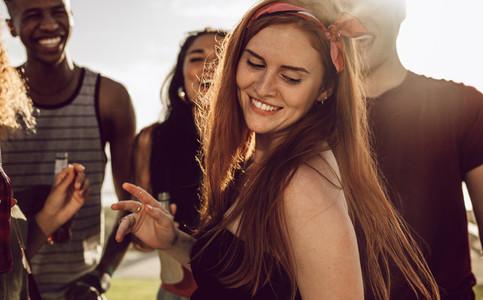 Beautiful woman dancing with friends
