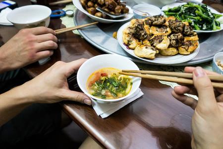Eating Vietnamese fish soup
