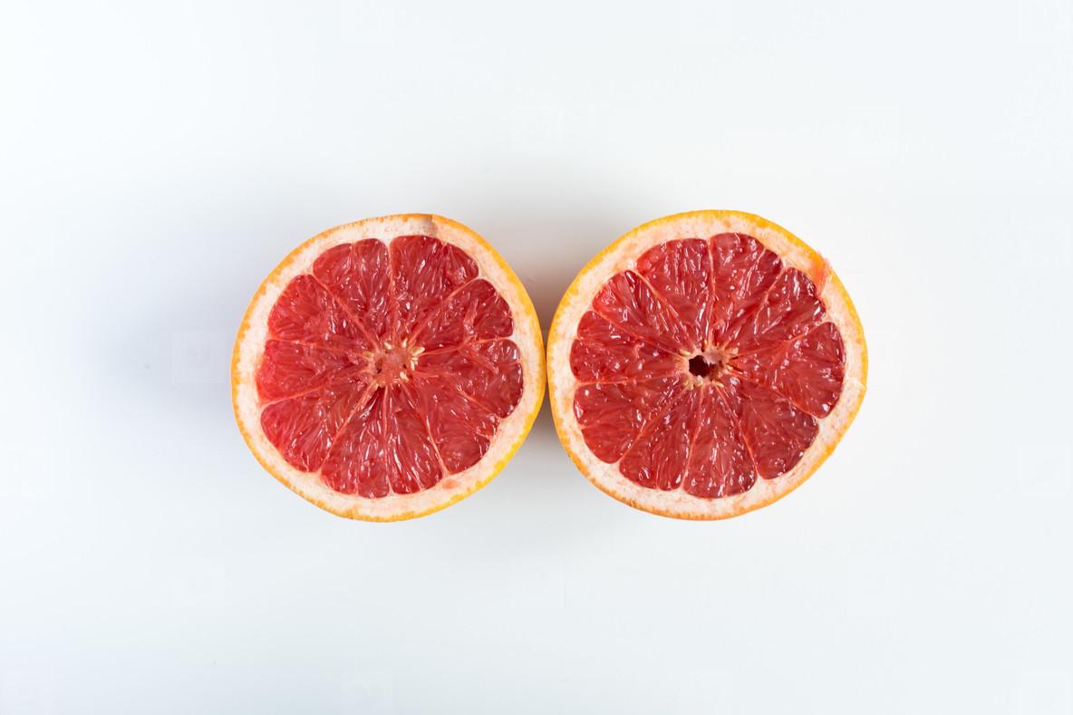 Freshly cut grapefruit in half