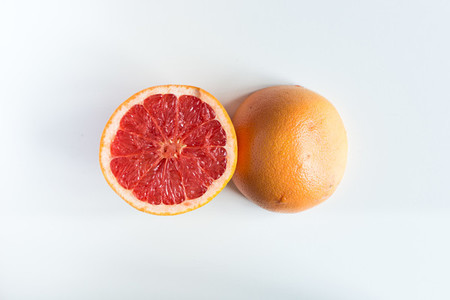 Freshly cut grapefruit in half