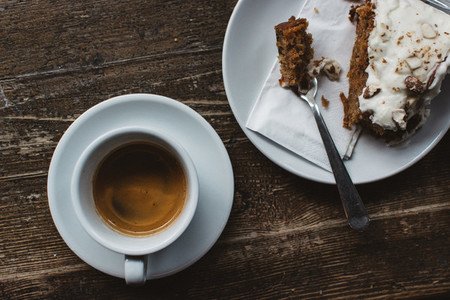 Having espresso with carrot cake
