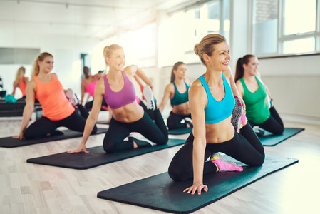 Group of women stretching in a fitness class