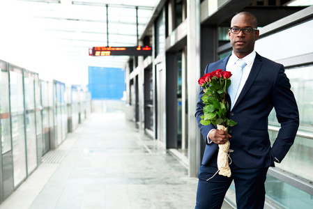 Businessman at Metro Holding Bouquet of Flowers