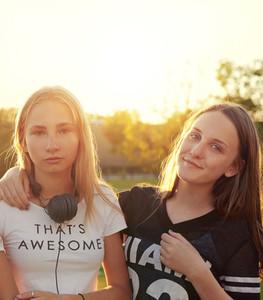 Two teenage girls outside