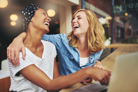 Two affectionate multiracial women friends