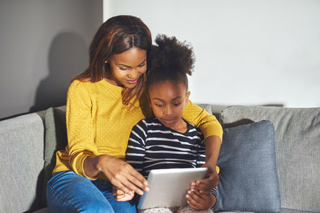 Mom and daughter with tablet