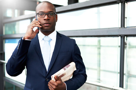 Young Businessman on Phone Looking at Camera