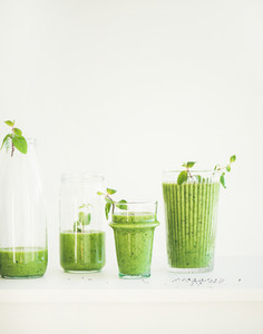 Matcha green smoothie with chia seeds in glasses  copy space