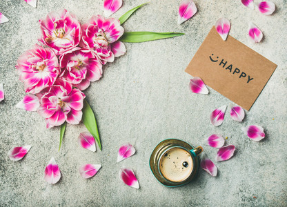 Cup of coffee  tulip flowers and sign happy  copy space
