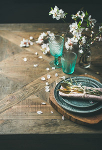 Spring Easter holiday Table setting over vintage wooden background