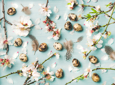 Easter background with eggs and Spring almond blossom flowers