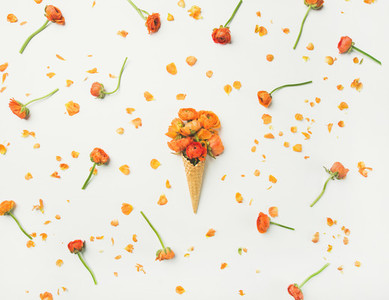 Waffle cone with orange buttercup flowers