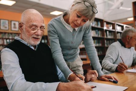 Close up of a university professor teaching an elderly man