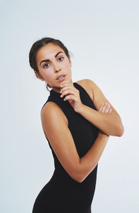 Thoughtful elegant young woman in black