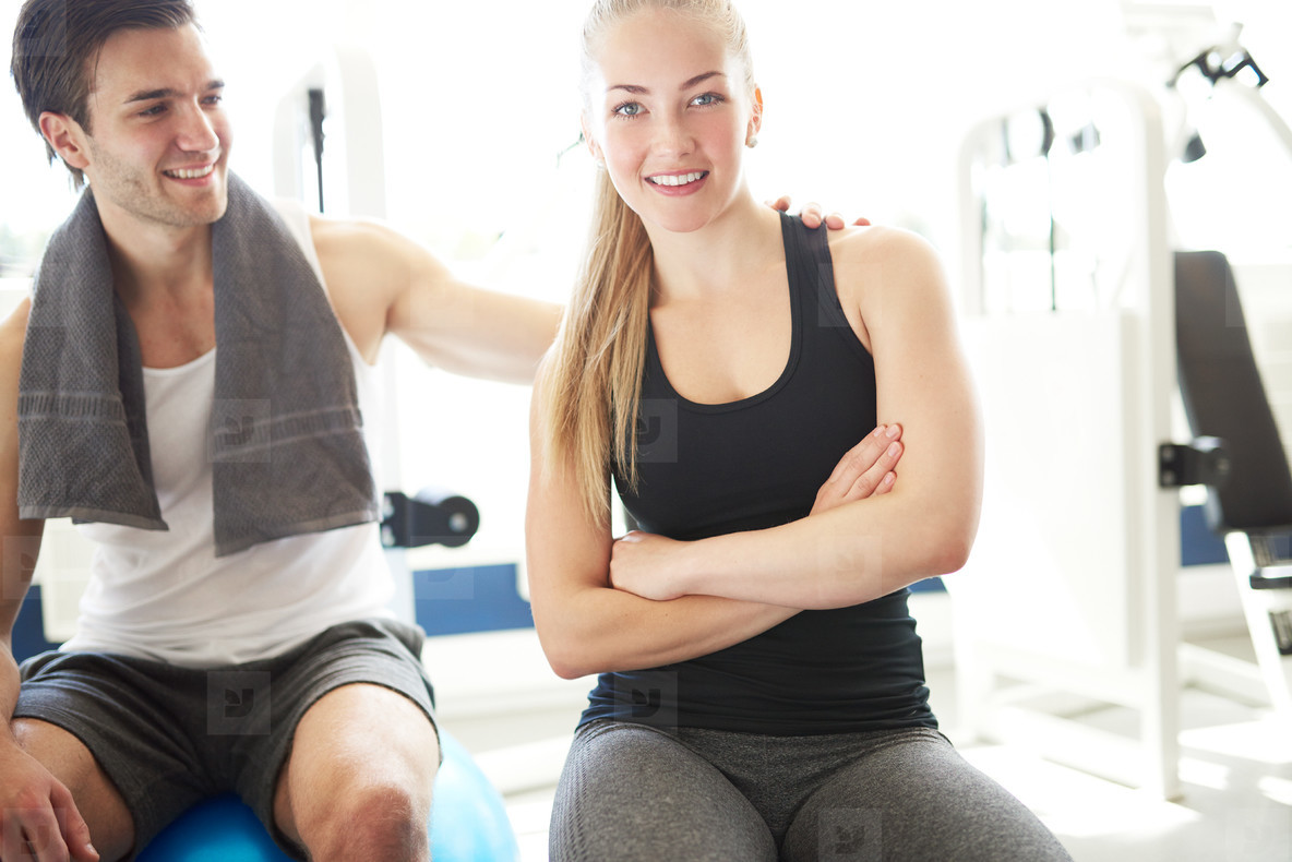 Young Man Admiring her Girlfriend in the Gym