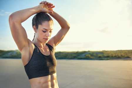 Fit young woman with toned abdominal muscles