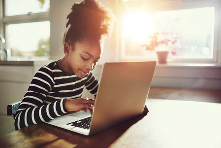 Young black girl using a laptop