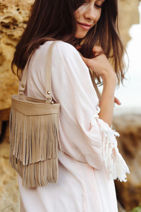 Young stylish girl wearing shorts and jacket
