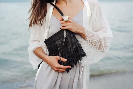 beautiful young girl with a handbag
