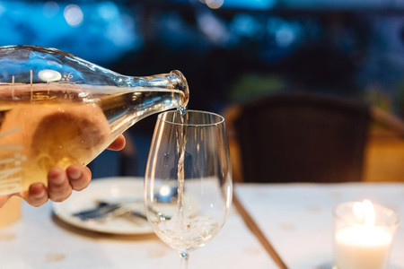 Wine is poured into a glass
