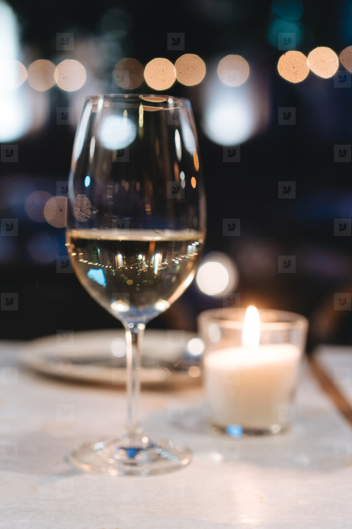 a glass of wine on the table