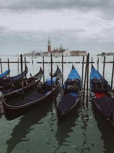 Gondolas moored by Saint Mark square