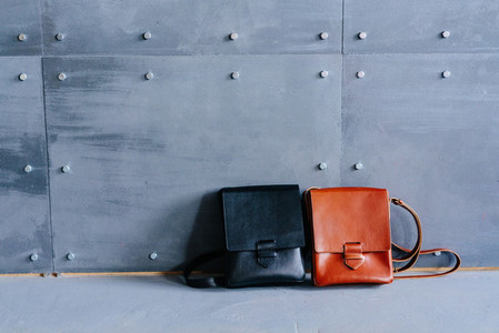 two leather bags on a gray background