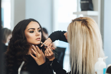 Makeup and hairstyle for a beautiful model
