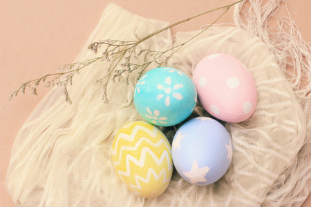 Pastel and colorful easter eggs on cloth with copy space happy