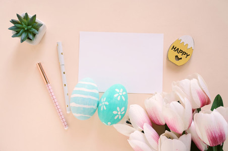 Happy Easter concept with blank card and colorful easter eggs an