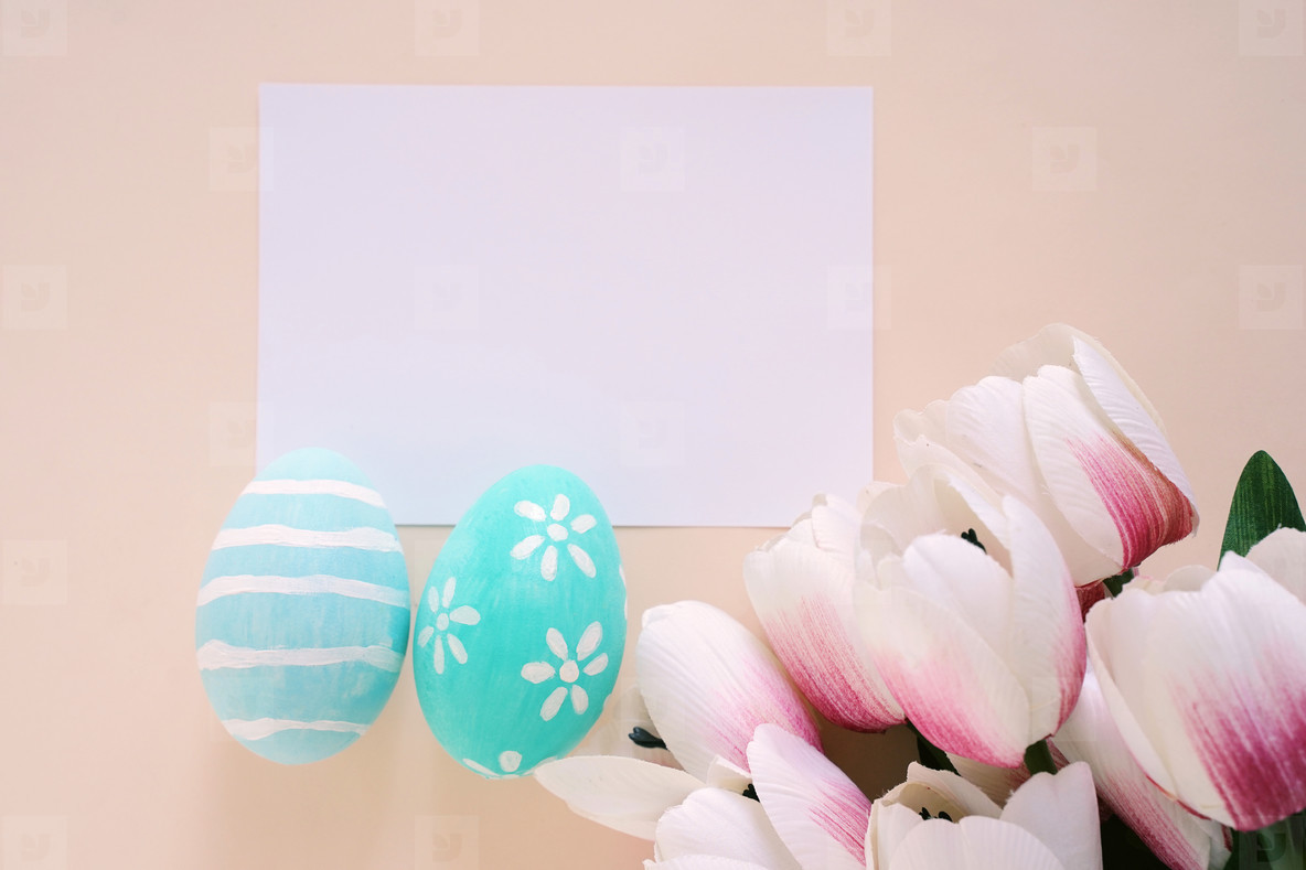 Happy Easter concept with blank card  colorful easter eggs and p